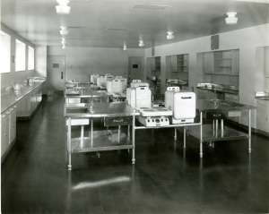A Home Economics classroom from Kingswood School, 1932.  Ironically, there's no kitchen sink in sight.