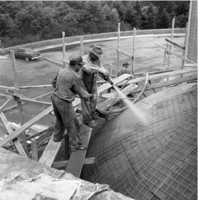 Workmen spray down the McMath Planetarium dome, which is under construction. 1955. Cranbrook Archives.