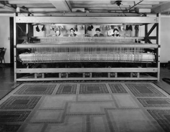 Studio Loja Saarinen weavers seated at one of the larger looms.  L to R: Elizabeth Edmark, Marie Bexell, Peggy Broberg, Gerda Nyberg.  May, 1935.  Cranbrook Archives.