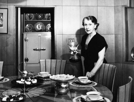 Loja Saarinen sets the table for guests.  Saarinen House, 1930-1940.  Cranbrook Archives.