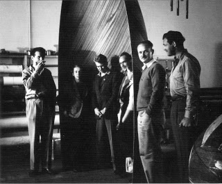 Eames Office staff with plywood glider nose section. Left to right: Charles Eames, Marion Overby, Gregory Ain, Harry Bertois, Ray Eames, William Francis and Norman Bruns. (Library of Congress Prints and Photographs Division. The Work of Charles and Ray Eames. Copyright, Eames Office).