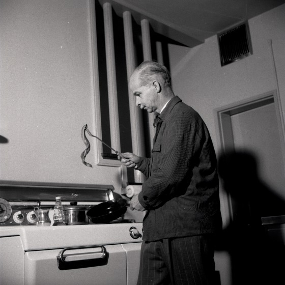 Dr. Robert Hatt cooking in Milles House.  1953, Cranbrook Archives.