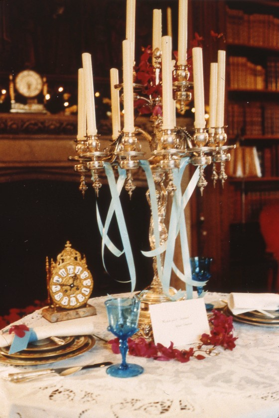 A 1988 Holiday Tables display features a candelabra and antique clock.  1988, Cranbrook Archives.