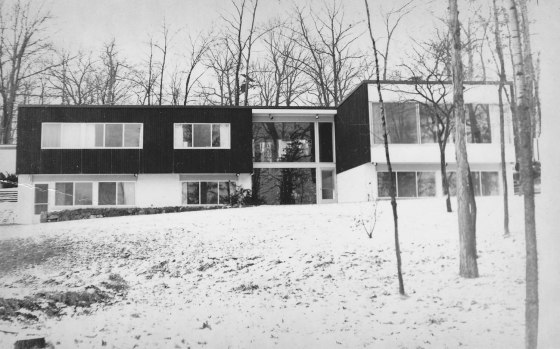 View of the house from the lakefront, with decorated Christmas tree in the entrance hall. 1955, courtesy Liz Buckner.