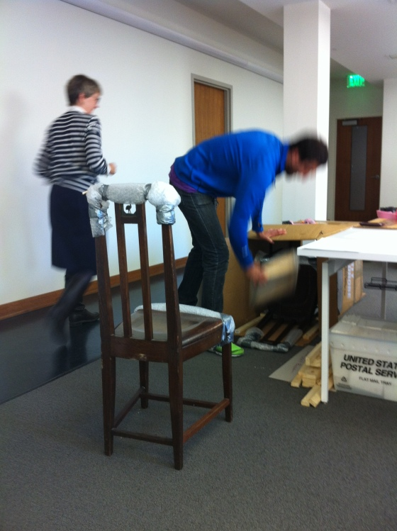 One of two Cranbrook School Dining Hall chairs being unpacked in the Center offices, November 2012.