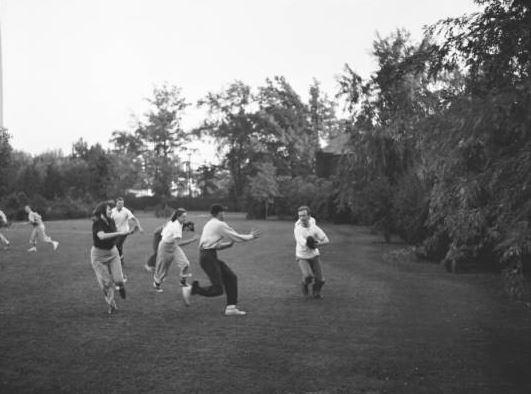 Ralph Rapson (left, holdign the football), plays football with fellow Cranbrook Academy of Art students. September, 1939. Richard P. Raseman/Cranbrook Archives