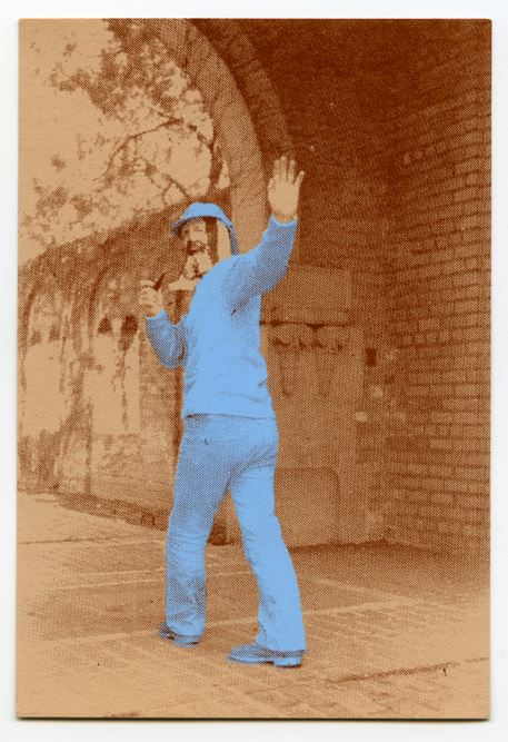 Limited edition postcard featuring CAA student Jim Poole wearing a Cage Bag as a mask on Cranbrook's campus, 1974. Courtesy Stephen Milanowski.