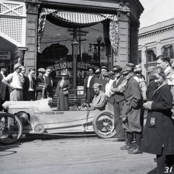James Scripps Booth showing off the JB Rocket prototype in Indianapolis, the conclusion of a test-drive from Detroit to Indiana, 1913. Cranbrook Archives.