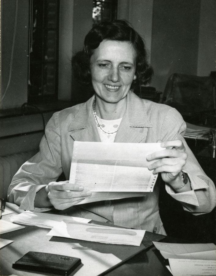 Helen McIlroy at her desk at Cranbrook House, 1950. Cranbrook Archives.