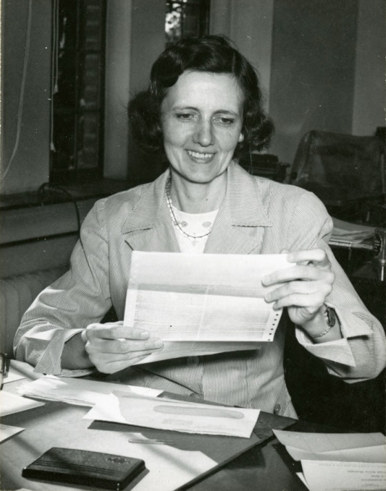 Helen McIlroy at her desk at Cranbrook House, 1950. Cranbrook Archives.