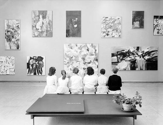 Young women take in the Annual Exhibition of Student Work at the Cranbrook Art Museum. The central painting is Untitled (1957) by student Frank Okada. June 1957. Harvey Croze/Cranbrook Archives.