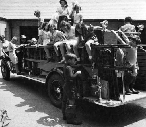 Brookside students enjoy the Cranbrook fire engine, 1936. Richard G. Askew/Cranbrook Archives.
