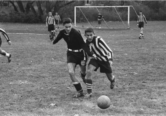 Cranbrook student John Vining Ogden (left) competes for the ball in a match against the opposing team from Nichols, a rival school, 1960. Cranbrook Archives/Harvey Croze.