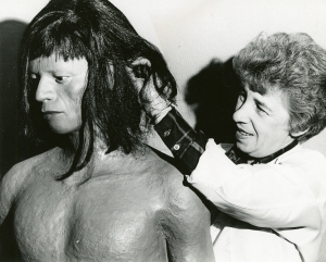 Betty Odle adjusts a wig on a Wayana figure, Aug 1969. Cranbrook Archives.