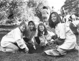 Middle School girls planting daffodils for Earth Day, 1990