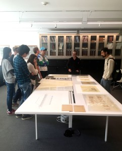 University of Michigan graduate students from the School of Architecture and Urban Planning look at drawings in the reading room.