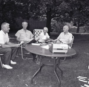 From left: Carleton McClain, Henry S. Booth and Margaret Russell interviewing former Cranbrook School Headmaster, Harry Hoey at his home, 1964.