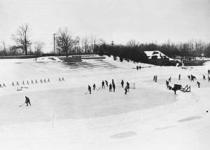 Boys from Cranbrook School playing hockey outdoors, 1928.