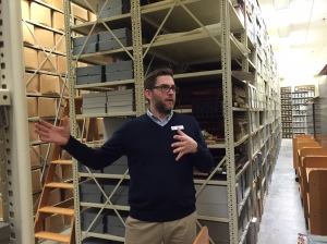 State Archivist, Mark Harvey, talks with our staff about processes at the Archives of Michigan.