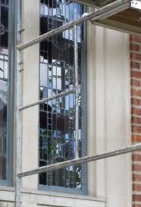 Glaziers from Thompson Art Glass reinstalling the window.