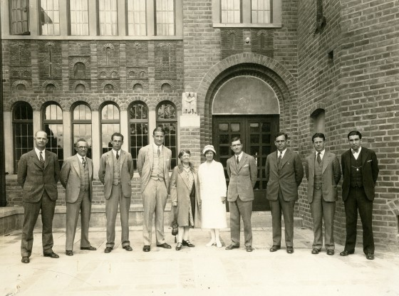 From left to right: Charles Keppel (Chemistry), John M. Harlow (French), George T. Mickelson (English), Herbert Snyder, Elizabeth Bemis (Dietician), Estelle Adams, (Nurse), William O. Stevens, Unidentified, C. Warren Moore (Arts & Crafts), Howard Yule (Latin)