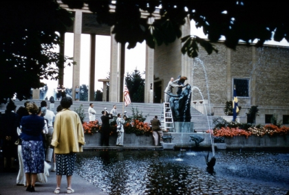 The Swedish Council Detroit places a wreath atop Milles' sculpture, Europa and the Bull. Henry Scripps Booth is holding the ladder and Cranbrook photographer, Harvey Croze, is in the foreground, to the left of the ladder. Courtesy Cranbrook Archives.