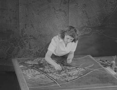 Alice Warren working on her city planning model for Plymouth, MI, 1944. Photographer, Harvey Croze. Courtesy Cranbrook Archives.