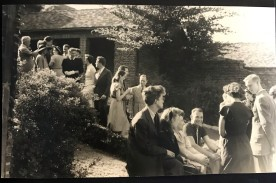 Guests gather in the Saarinen residence courtyard, ca 1938.