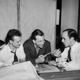 Rapson (left), with Eero Saarinen and Fred James working on a competition drawing for the Festival Theatre at the College of William and Mary, 1939.