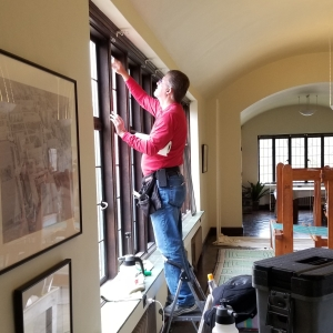 Bill Kish of SRF Enterprises, Inc. installing window film in Saarinen House Studio.