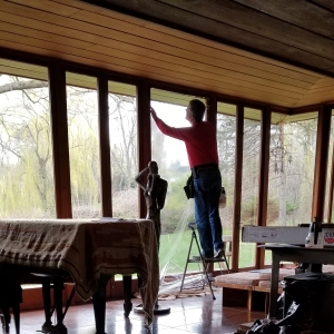 Bill Kish of SRF Enterprises, Inc. installing window film in Smith House.