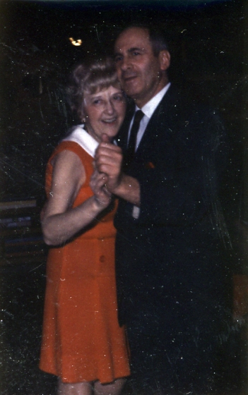 Sara and Melvyn Smith dance together in Smith House.
