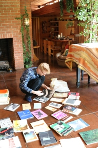 Mr. Adkisson, at Smith House, organizing Smiths' pamphlets, brochures and magazines.