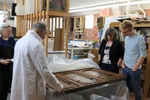 Ken Katz, Mrs. Mio, and Mr. Adkisson discuss restoration plans for the painting on wood panels— Flora, Ceres, Pomona (Three Goddesses) by Corrado Scapecchi.