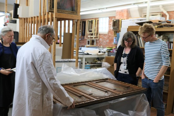 Ken Katz, Mrs. Mio, and Mr. Adkisson discuss restoration plans for the painting on wood panels— Flora, Ceres, Pomona (Three Goddesses) by Corrado Scapecchi.