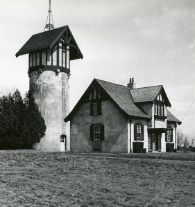 Tower Cottage circa 1915 with water tower behind.