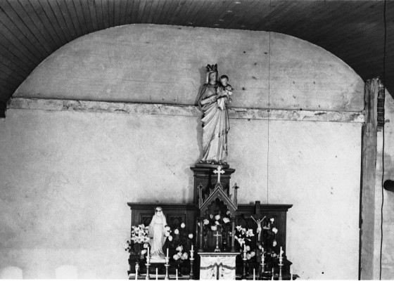 Abandoned building from the House of David Colony on High Island. This is likely an interior of the old Catholic Church once used as a schoolhouse. Photo by Robert Hatt. Courtesy Cranbrook Archives.