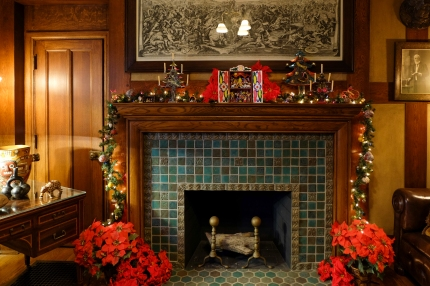 The mantle in Mr. Booth's Original Office, featuring Mexican tin trees and a Peruvian retablo.