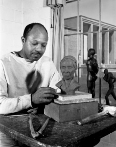 Oliver LaGrone in his studio at Cranbrook Academy of Art circa 1942 with a model of his bust of Harriet Tubman. Courtesy Cranbrook Archives.