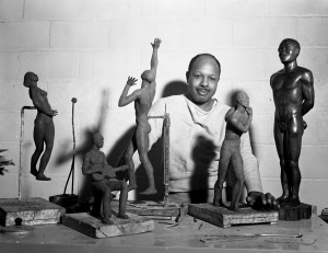 Oliver LaGrone in his studio at Cranbrook Academy of Art circa 1942 with some of his works. Courtesy Cranbrook Archives.